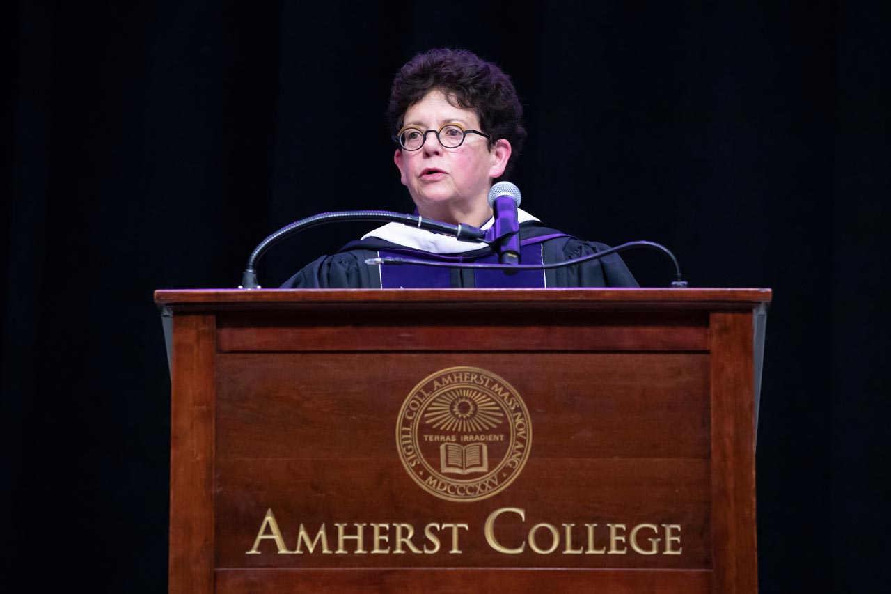 Biddy Martin at podium delivers commencement address