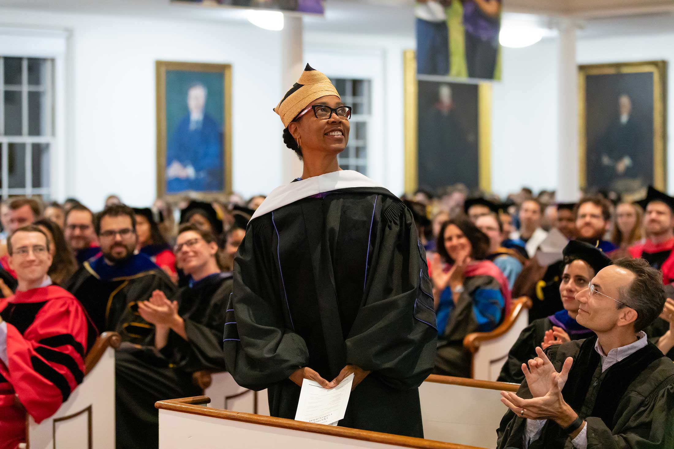 Professor Sonya Clark stands for recognition from her peers.