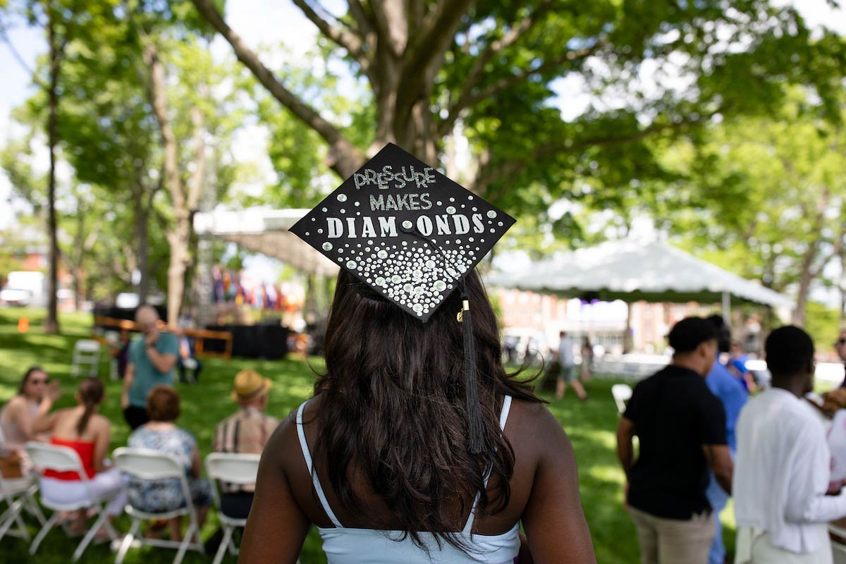 A student with a decorated graduation cap