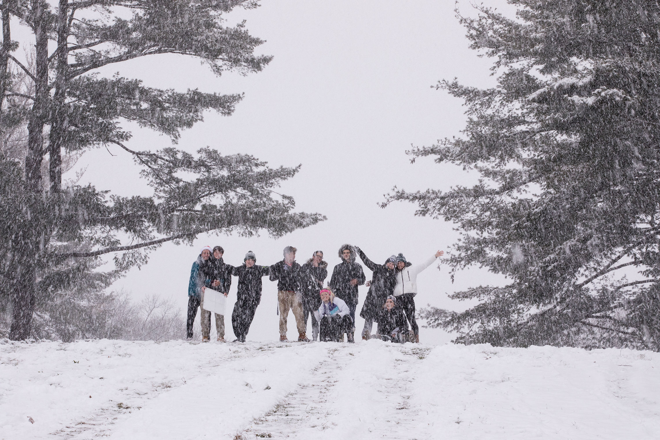 Students sledding on the Amherst College campus.