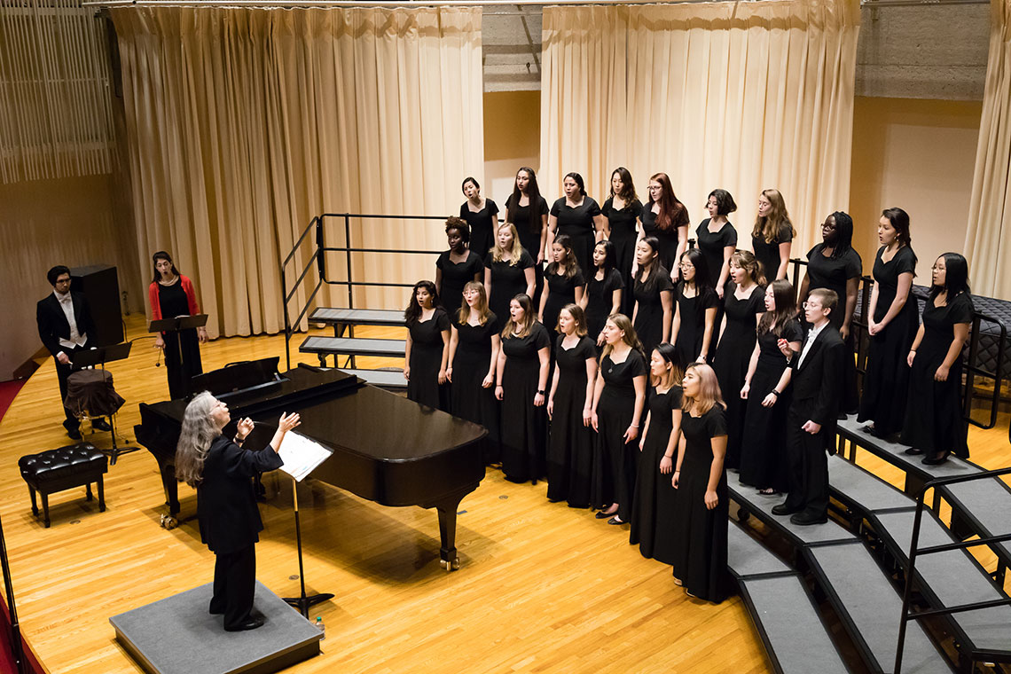 Mallorie Chernin conducts at the Amherst College Choral Society Concert.