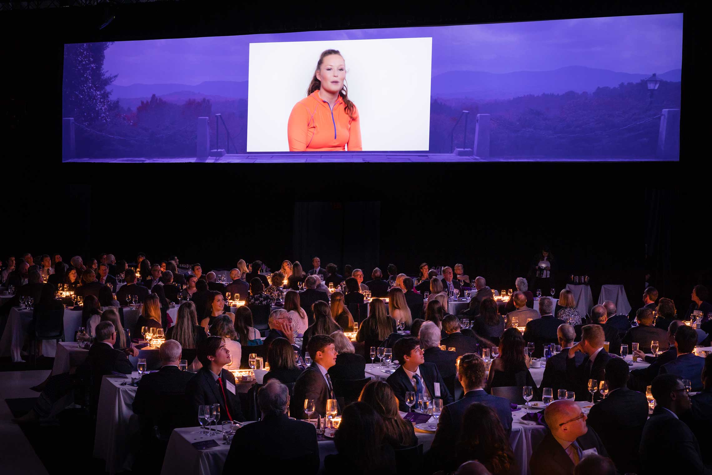 A video plays during the campaign launch dinner