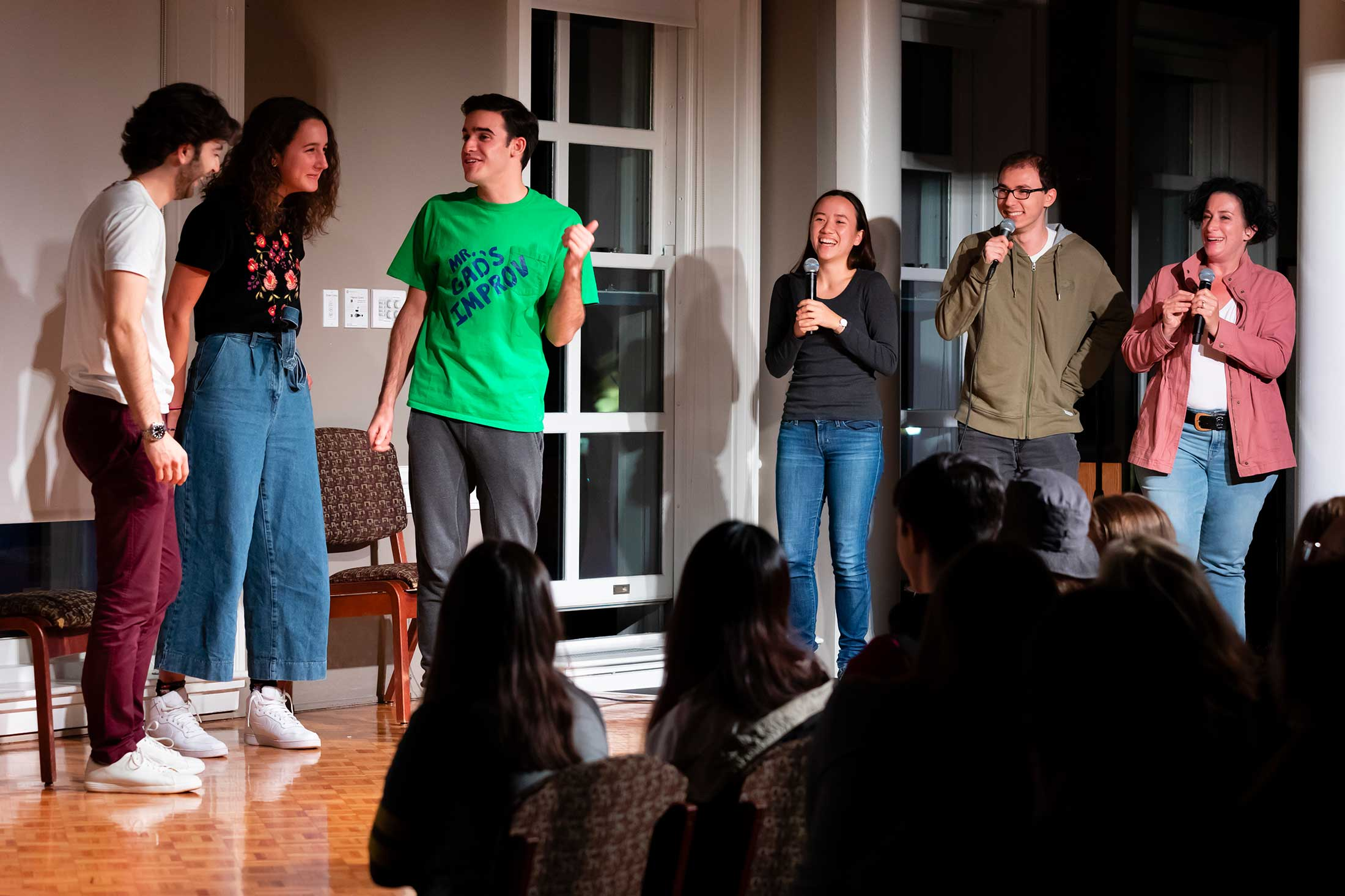 Students on stage performing improv