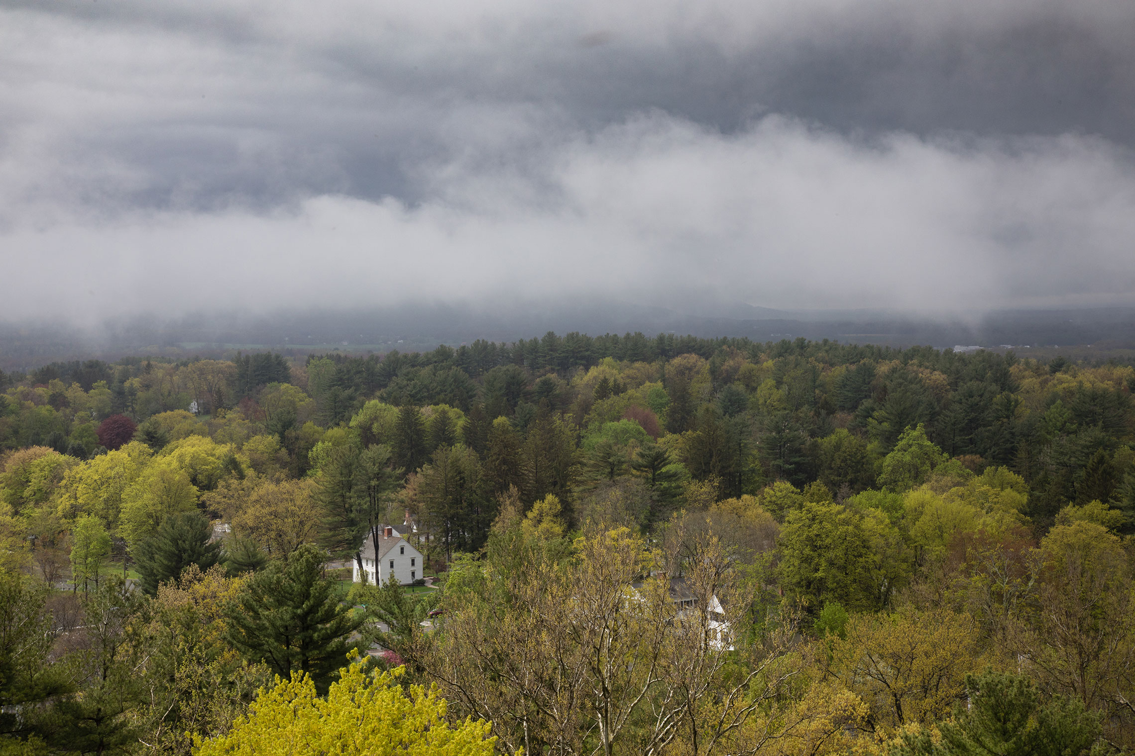 Aerial view of Amherst College under cloudy skies.