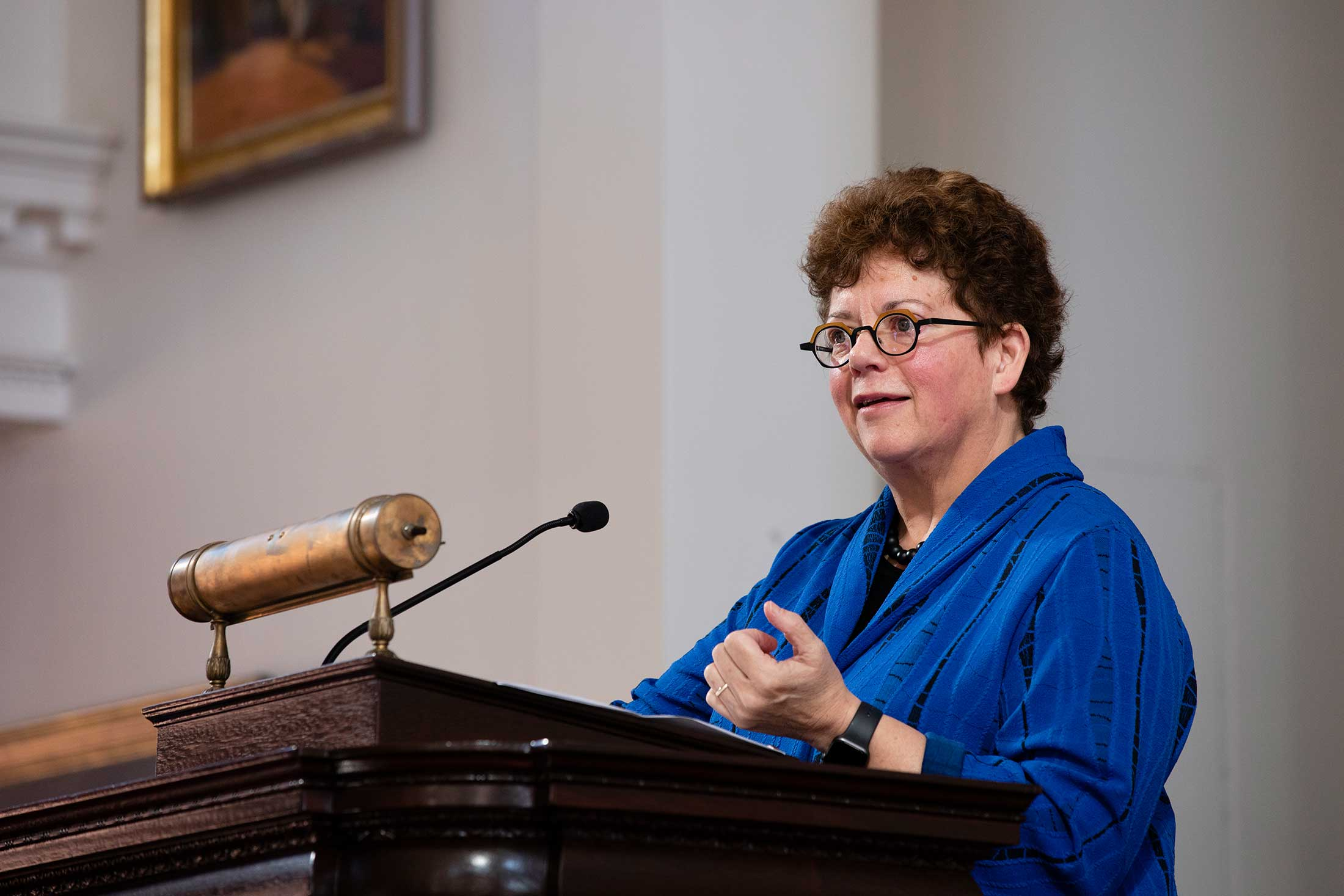 President Biddy Martin behind a podium speaking during Family Weekend 2019