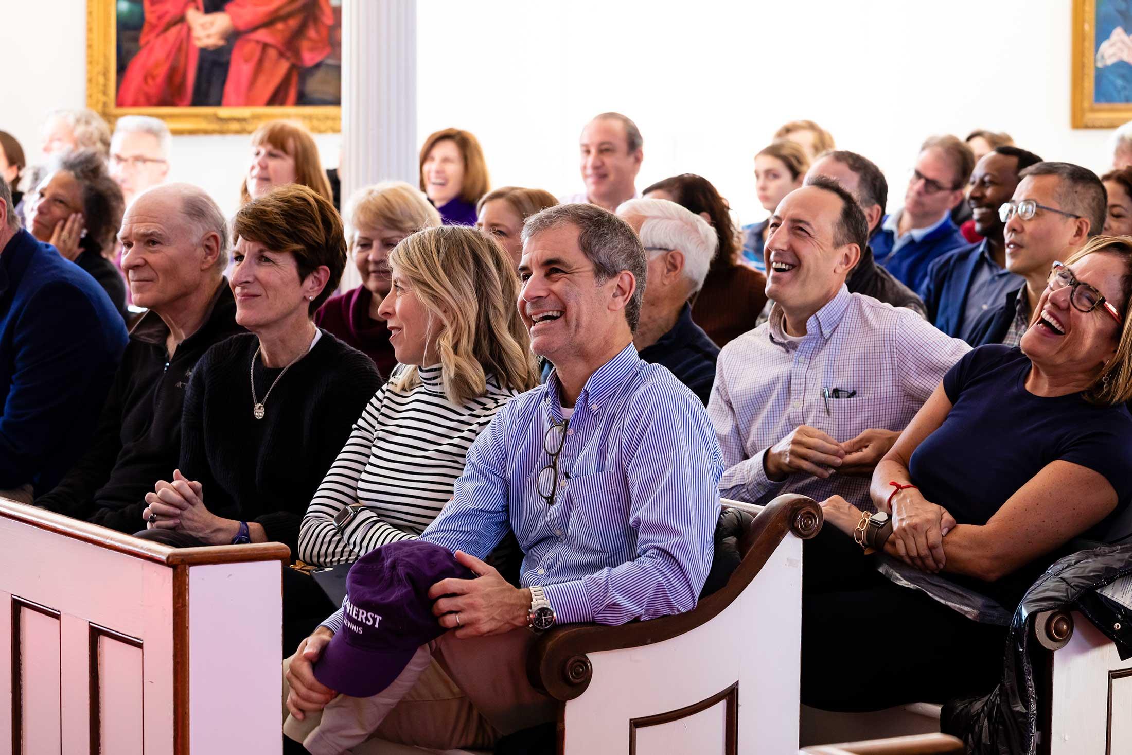 Audience members listening to President Martin speka