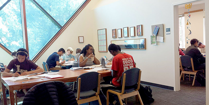 Students studying together at a large table