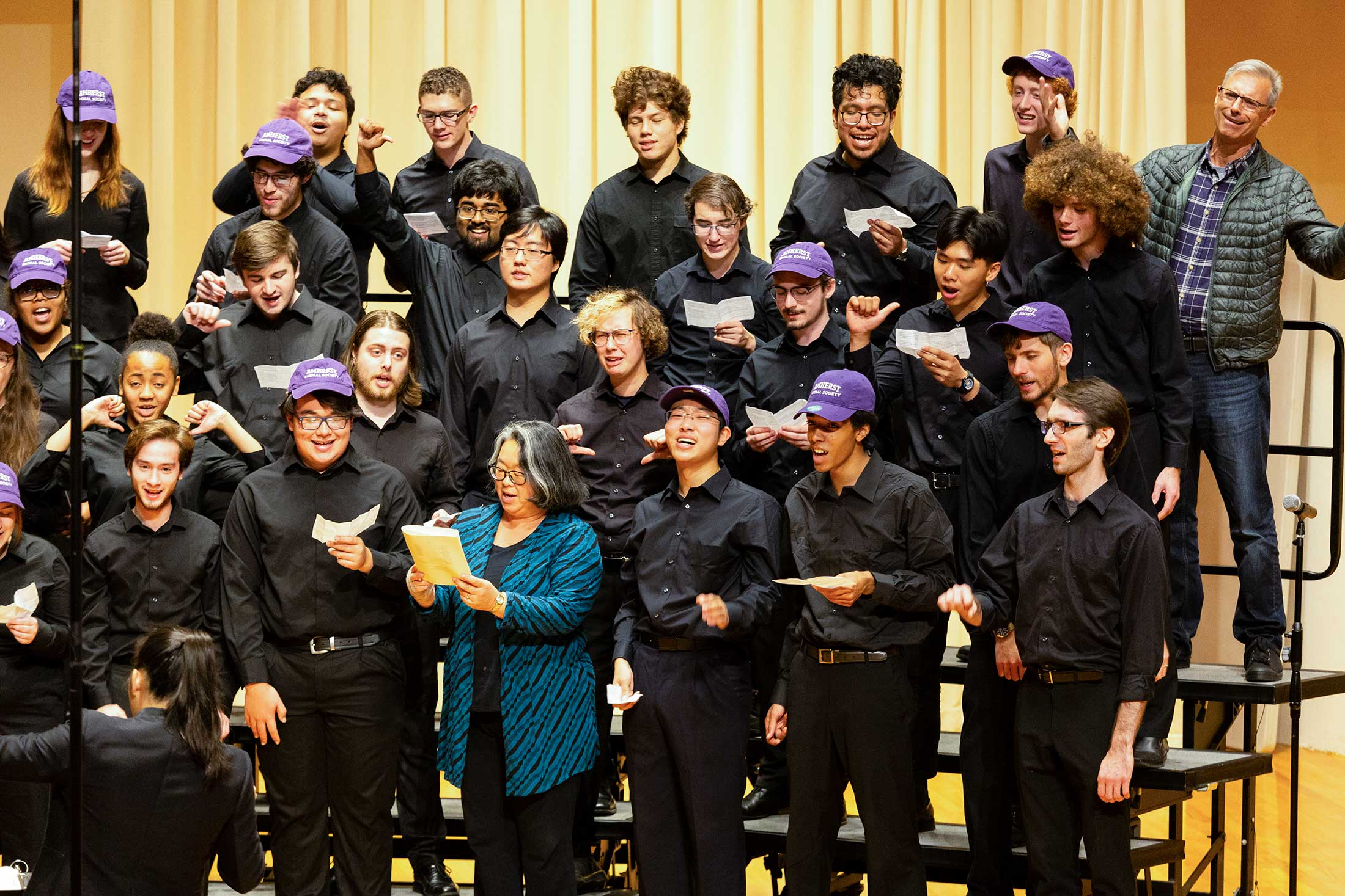 The Amherst College Choral Society, plus a few parents, performing during Family Weekend