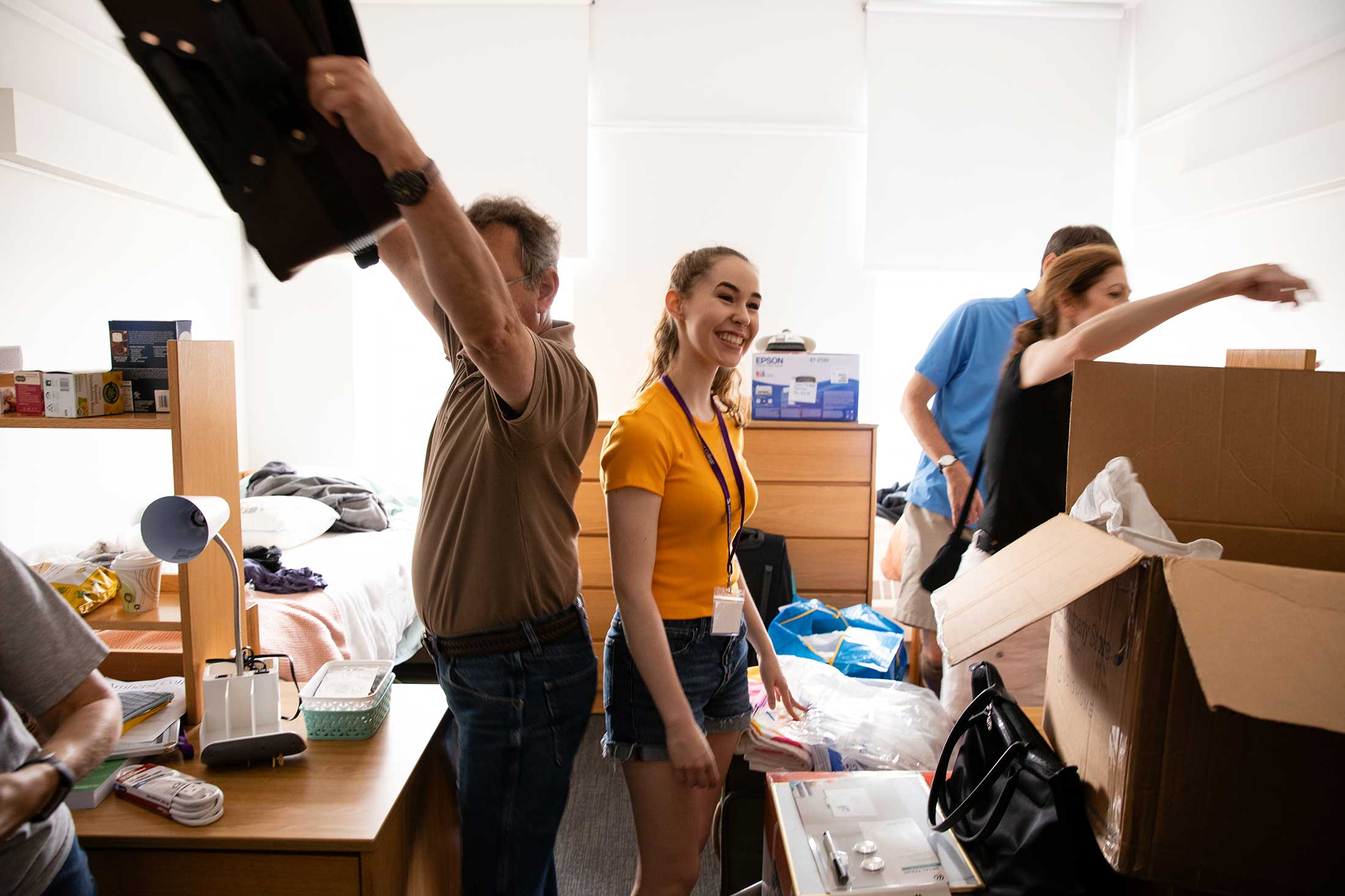 New roommates and their parents unpack belongings in Appleton Residence Hall