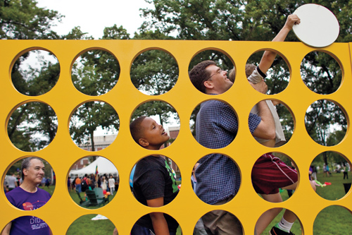 Party goers play on life size Connect Four game