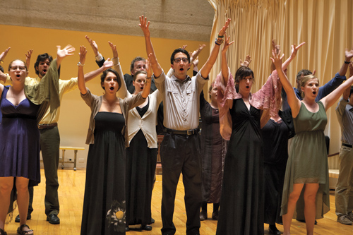Performers on stage at rehearsal of opera