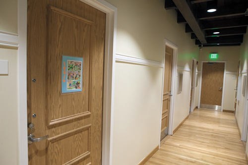 Hallway in Seligman with exposed beams and natural wood flooring