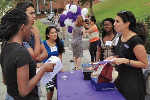 Outside Keefe Campus Center, Edith Cricien '14 enrolls students in Pathways, a new mentoring program
