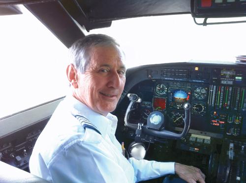 Randy Davis '76 in cockpit
