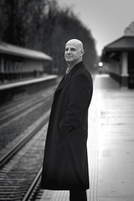 Harlan Coben '84 standing on train platform