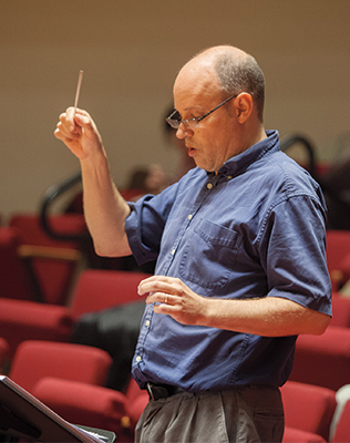 Photo of Eric Sawyer conducting rehearsal in Buckley Recitial Hall