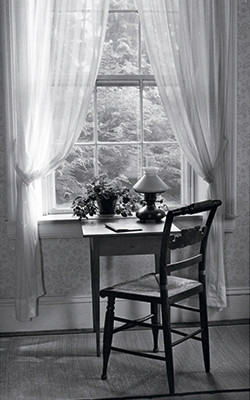 Chair and desk facing window in Dickinson's home