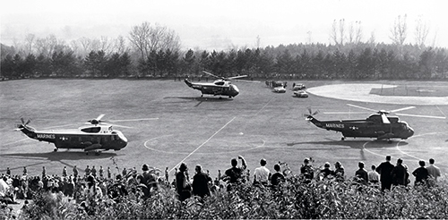 Three helicopters landing on Memorial Field