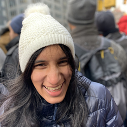 Aditi on a cold day in a crowd of people