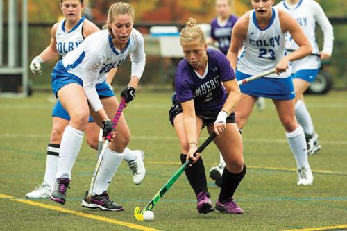 Field hockey player, Annika Nygren, dribbling past opponents