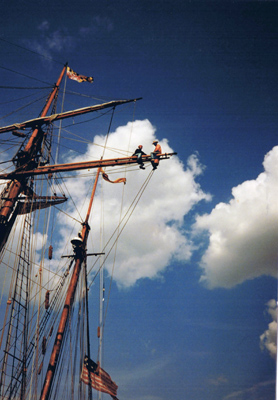 2 people on rigging of tall-ship