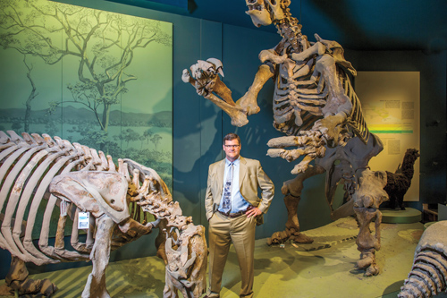 Kirk Johnson '82 among dinosaurs at Smithsonian Museum of Natural History