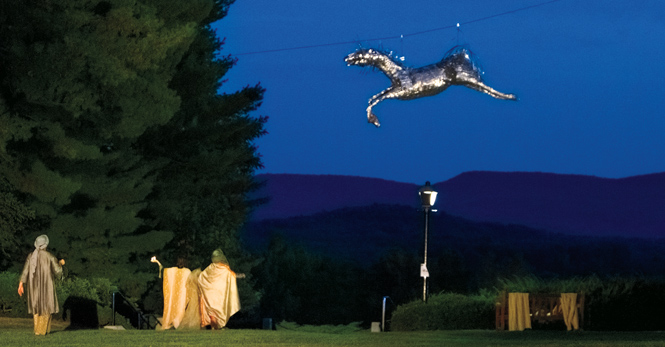 Silver horse suspended from trees in quad