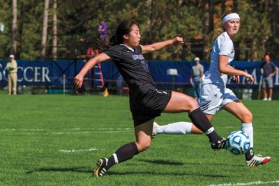 Soccer phenom, Megan Kim '16, dribbles through Bates defense.