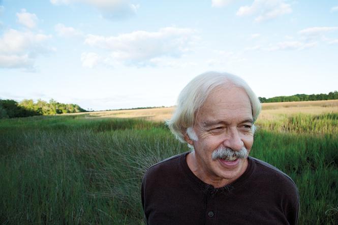 Theodore Rosengarten '66 standing in grassy field