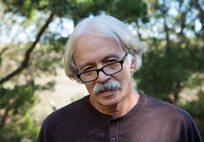 Theodore Rosengarten '66 standing in wooded area