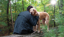 Peter Zheutlin '75 with Albie sitting on log