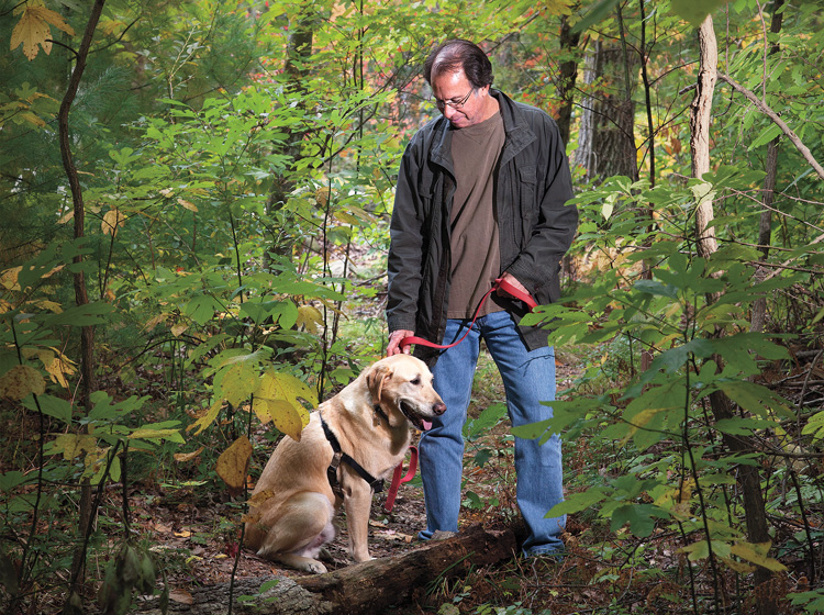 Peter Zheutlin '75 with Albie posing in woods