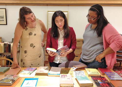 Danielle Trevino '14 reviewing collection with Professor Brooks