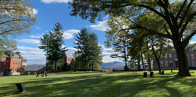 The Amherst College quad in bright sunlight with Mount Holyoke in the distance
