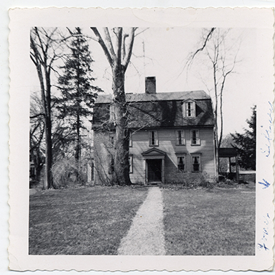 A photo of Strong House, a saltbox house on the campus Amherst College