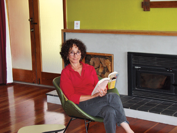Deborah Gewertz seated, holding her book