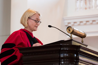 Catherine Epstein, Dean of the Faculty, speaking at a podium
