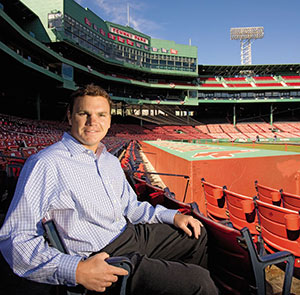 Cherington seated in the bleachers of Fenway Park