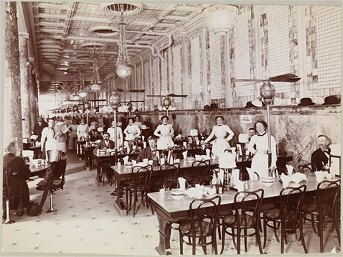 Black-and-white photo of a restaurant and its employees