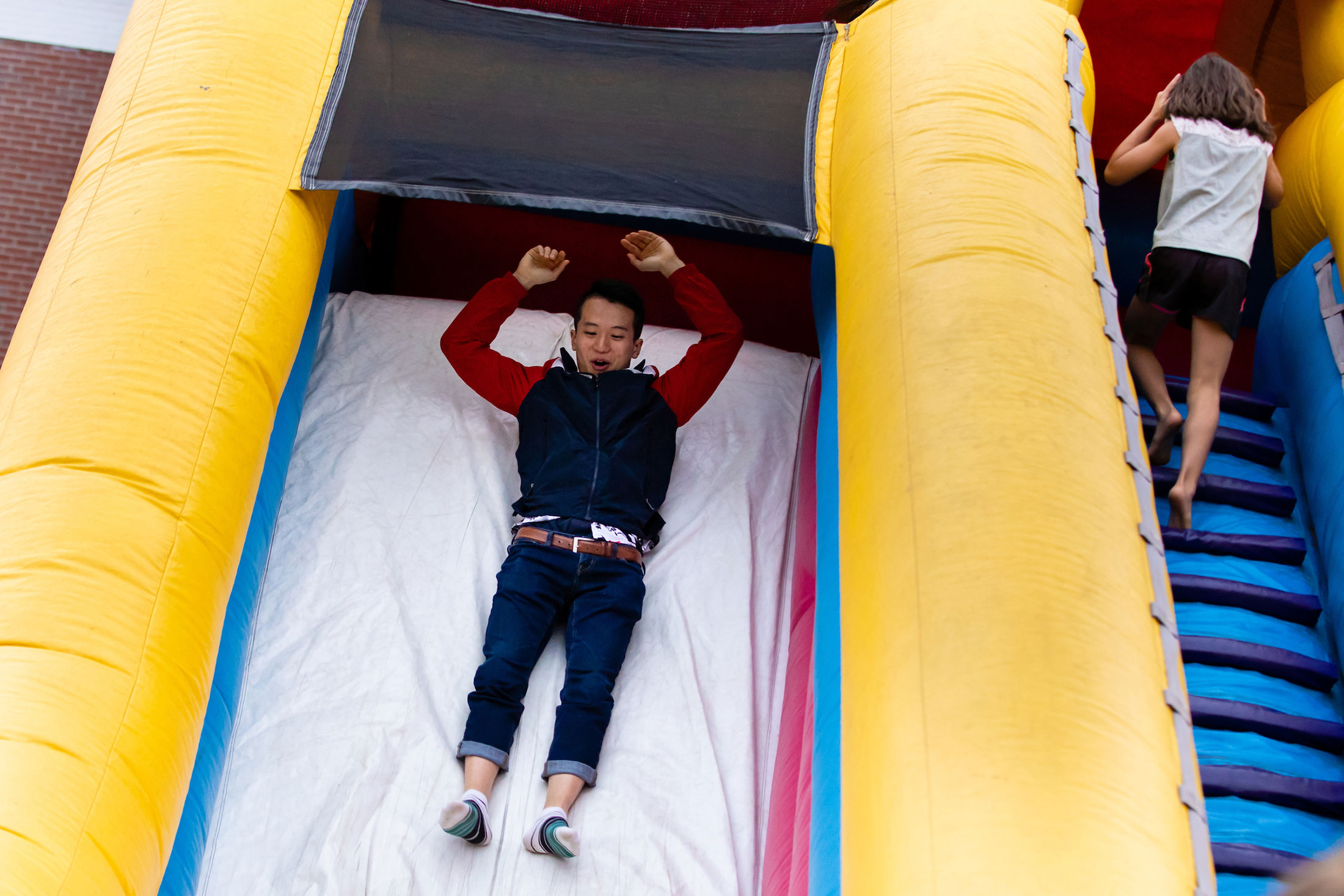 Riding on the bouncy slide
