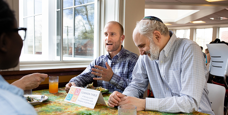 Harrison Blum and Rabbi Bruce Bromberg Seltzer at a table in Valentine Hall