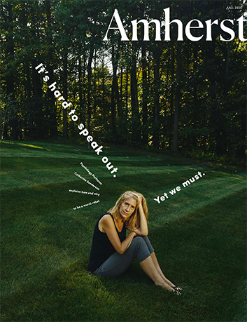 The cover of the fall 2020 issue of Amherst Magazine showing a woman sitting in a field