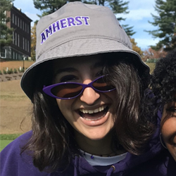 Dalya smiling while wearing a lot of Amherst gear