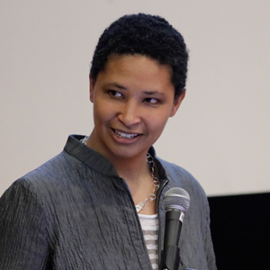 Danielle S. Allen speaking at a microphone