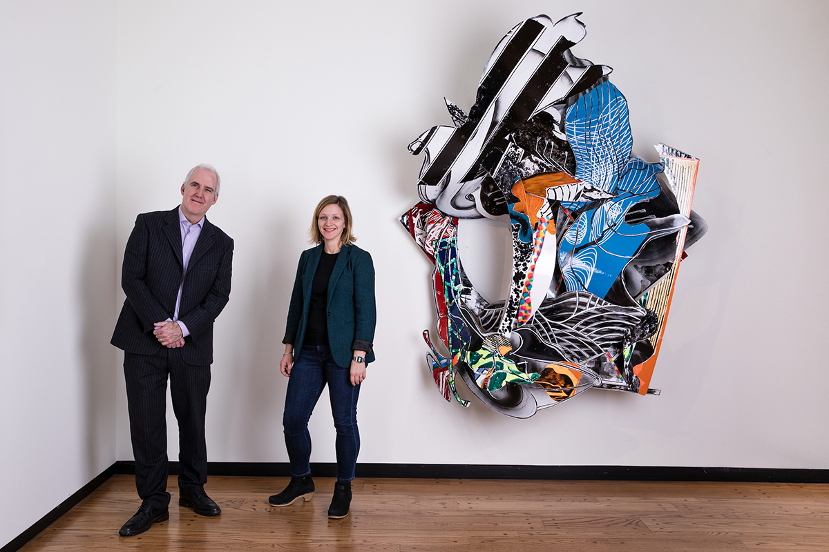 David Little and Emily Potter-Ndiaye in front of a modern art work in the Mead Museum