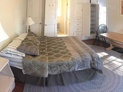 Interior of the East Suite Room on the Bailey Brown House showing the bed and seating options