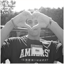 Alex Sondak 13 making a heart with his hands black and white
