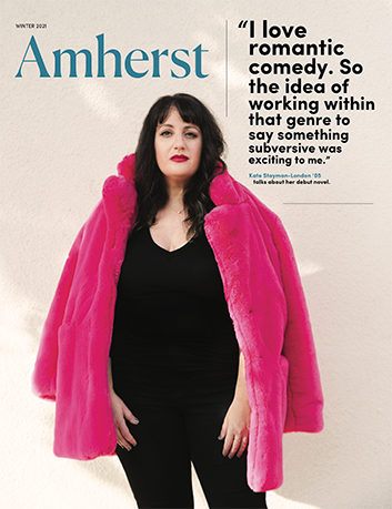 The front cover of Amherst Magazine featuring a woman dressed in black with a pink shawl around her shoulders