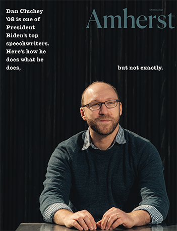 The cover of the spring 2021 Amherst Magazine showing a man against a dark background