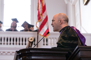 Geoffrey Sanborn speaking at a podium